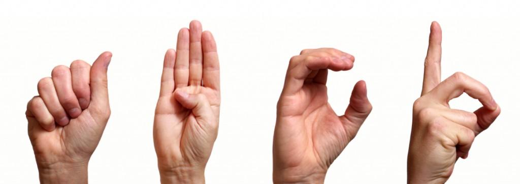 Hands signing A B C D