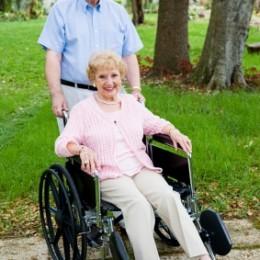 man pushing a woman outdoors