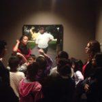 Children in front of artwork